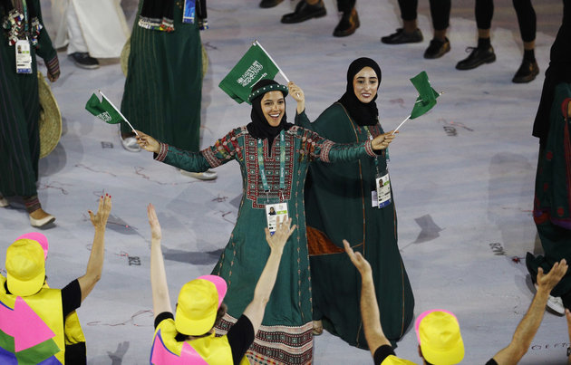 2016 Rio Olympics - Opening ceremony - Maracana - Rio de Janeiro, Brazil - 05/08/2016. Sarah Attar (KSA) of Saudi Arabia waves flags during the opening ceremony. REUTERS/Stoyan Nenov FOR EDITORIAL USE ONLY. NOT FOR SALE FOR MARKETING OR ADVERTISING CAMPAIGNS.