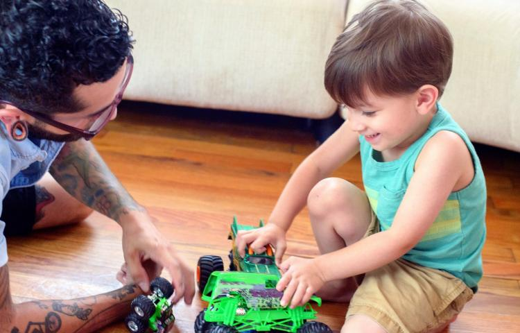 Man watching son play with toys