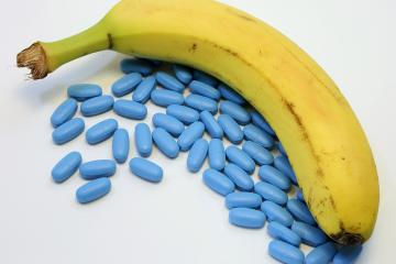 yellow banana with many blue pills for male problems