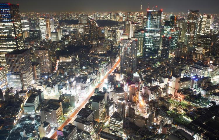 Cityscape view with skyscrapers and city lights at night, Tokyo, Japan