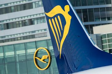 A tailfin with the Ryanair logo (L)can be seen in front of the logo of the airline Lufthansa  at the airport in Frankfurt am Main,Germany, 02 November 2016. Two Lufthansa airplanes can be seen in the background. Airport operator Fraport and the Irish discount airline Ryanair are delivering statements at a joint press conference on the Ryanair's future offerings at the Frankfurt am Main airport. For the occasion, an airplane from Rynair landed for the first time at the airport. Photo:ANDREASARNOLD/dpa