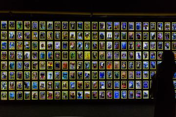 A visitor looks at the covers of National Geographic Magazine in the history displayed at the National Geographic Exhibition in Xi'an city, northwest China's Shaanxi province, 19 September 2017.  The National Geographic Exhibition kicked off in Xi'an city, northwest China's Shaanxi province, 19 September 2017. The show includes many of the best photos to run in the magazine since it was first published in 1888, including some from remote corners of the planet.