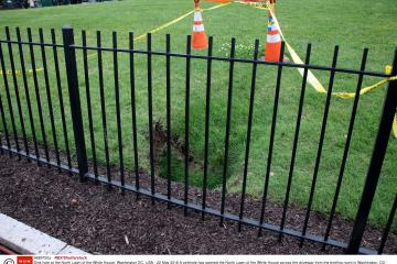 Mandatory Credit: Photo by REX/Shutterstock (9689720a) A sinkhole has opened the North Lawn of the White House across the driveway from the briefing room in Washington, DC. Sink hole at the North Lawn of the White House, Washington DC, USA - 22 May 2018